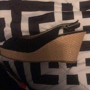 A tan and black wedge heel